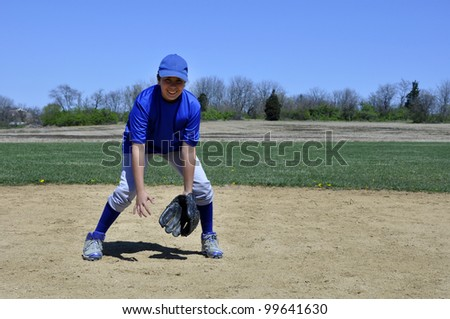 young infield baseball player ready to get a ground ball