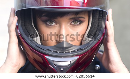 Young Intense Girl in Red Full Face Motorcycle Helmet - stock photo
