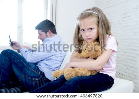 young internet addict father using mobile phone ignoring little sad daughter looking bored hugging teddy bear abandoned and disappointed with her dad in parent bad selfish behavior - stock photo