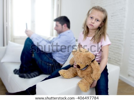 young internet addict father using mobile phone ignoring little sad daughter looking bored with teddy bear abandoned and disappointed with her dad in parent bad selfish behavior - stock photo