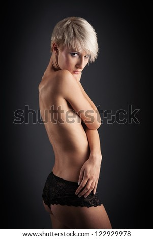 Young intimate woman beauty portrait against dark background. - stock photo
