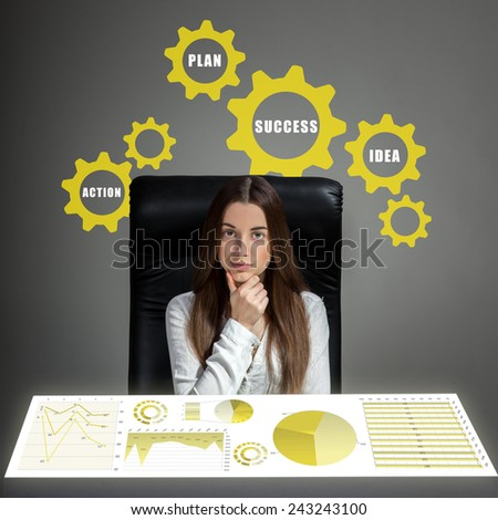 Young inventive woman thinking and analyzing business plan or business calculations - stock photo