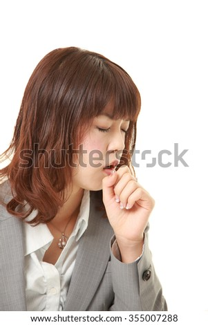 young Japanese businesswoman coughing