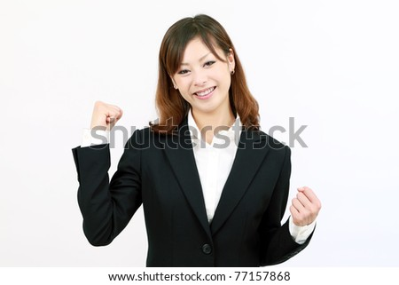 Young japanese businesswoman happy success - stock photo