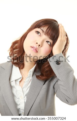 young Japanese businesswoman has lost her memory - stock photo
