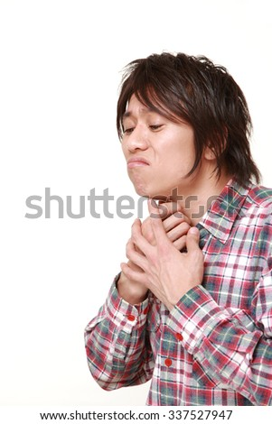 young Japanese man having throat pain