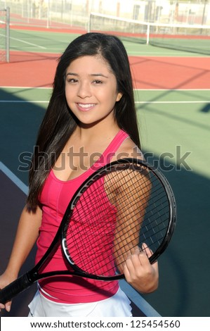 Young Japanese Tennis Player/Asian Female Player/Early morning on the tennis court with Japanese player - stock photo