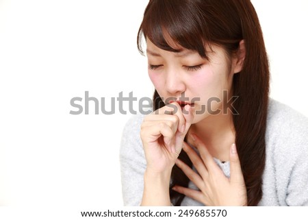young Japanese woman coughing? - stock photo