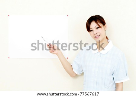 Young japanese woman hand showing blank paper