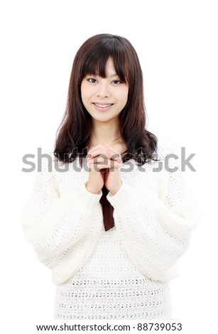 Young japanese woman holding hands together and smiling