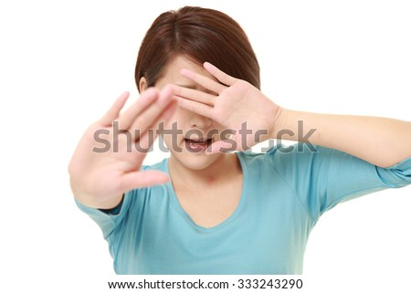 young Japanese woman making stop gesture
