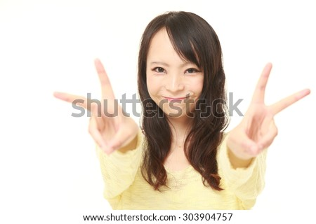 young Japanese woman showing a victory sign