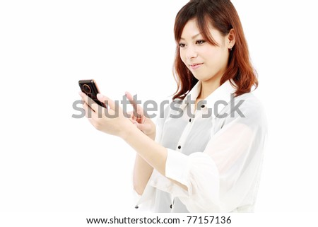 Young japanese woman with mobile phone - stock photo