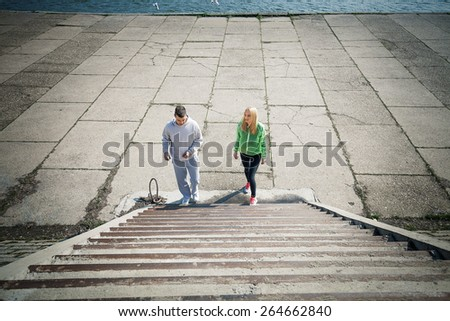 Young joggers preparing to run up the stairs