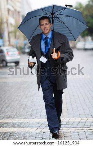 young journalist rushing in urban city for breaking news - stock photo