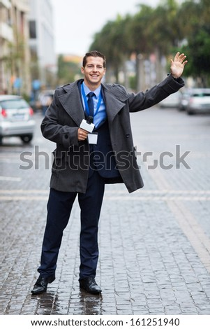 young journalist waiting for a cab - stock photo
