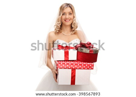 Young joyful bride holding a bunch of wedding presents isolated on white background