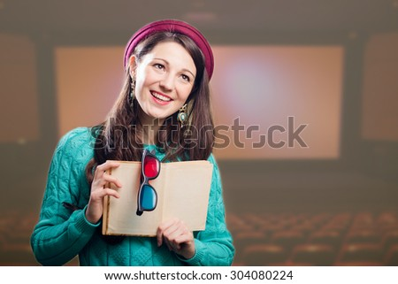 Young joyful brunette girl with 3d glasses and book. - stock photo