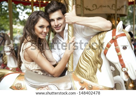 Young joyful couple visiting an attractions park  - stock photo