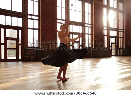 Young juggler performing - stock photo