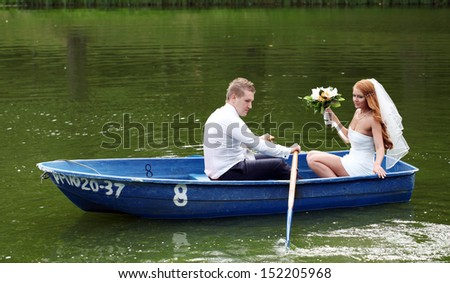 Young just married bride and groom embracing