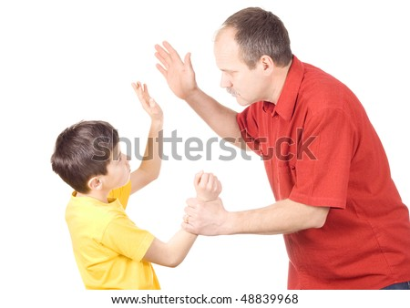 Young kid about to be thumped by father