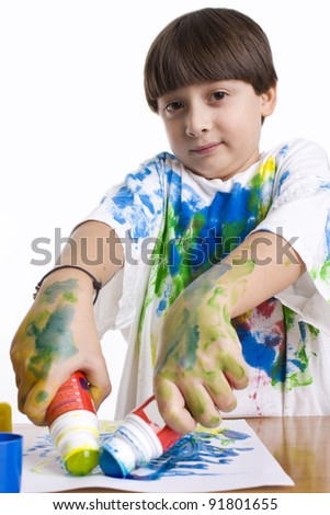 Young kid artist painting on the paper