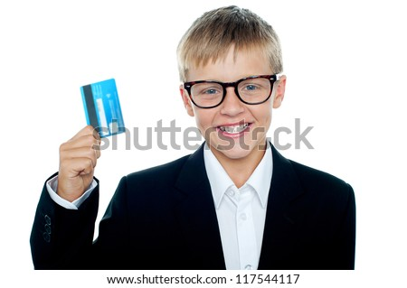 Young kid in business suit flaunting a debit card. Wanna go shopping?