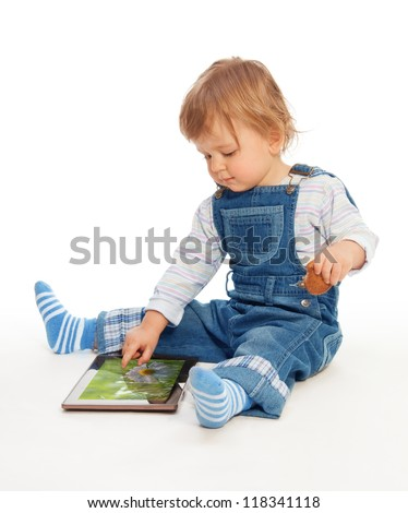 Young kid playing with tablet pc (image on the screen from my portfolio) - stock photo