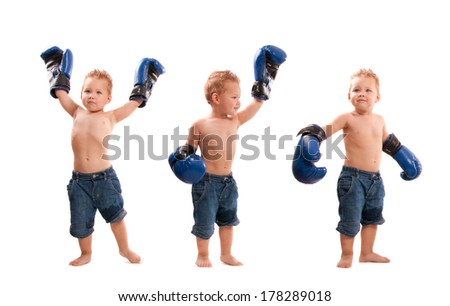 Young kid with boxing gloves in winning poses  - stock photo