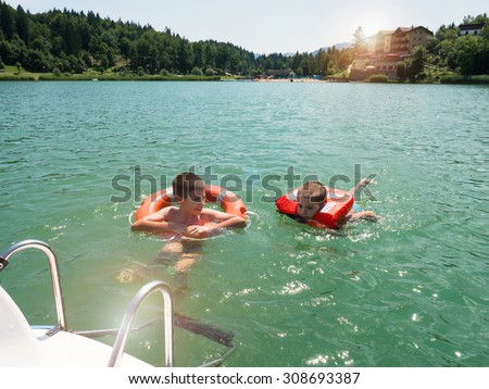 Kids Swimming In A Lake swimming lake stock images, royalty-free images & vectors