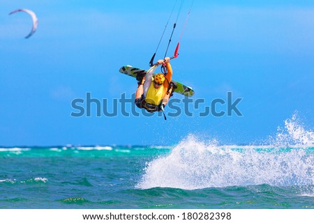 young kite surfer on tropical sea background Extreme Sport Kite surfing - stock photo