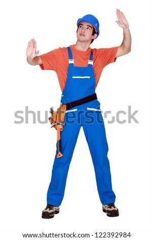 Young laborer gesturing - stock photo