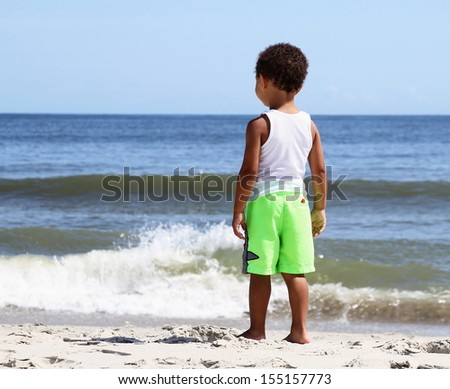 Young Lad watching the surf