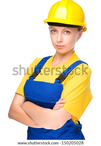 Young lady as a construction worker crossed her arms, isolated over white - stock photo