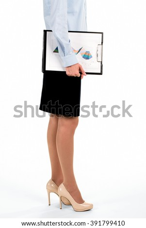 Young lady carrying graphic charts. Businesswoman holding clipboard with charts. Our new senior analyst. First day at credit department. - stock photo