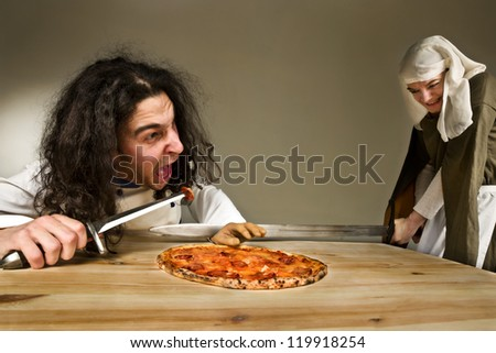 young lady cutting the hand of gluttonous servant who stealing the pizza - stock photo