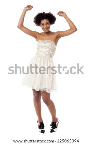 Young lady dancing with raised arms, beautiful corset attire.