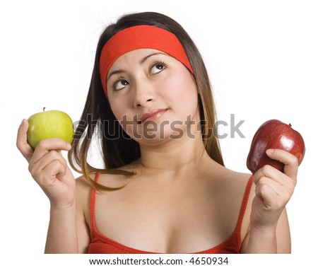 Young lady deciding which apple to eat
