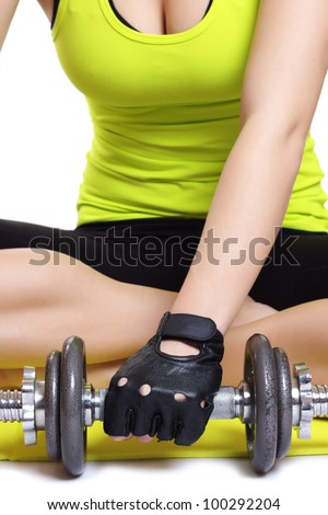 Young lady doing workout with weights - stock photo