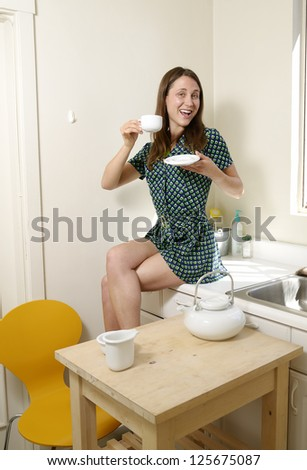 Young lady enjoys her cup of tea