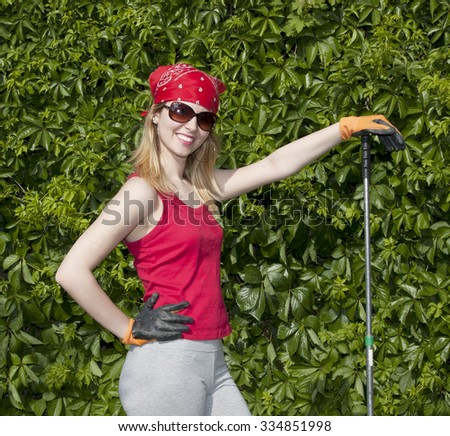 Young lady gardner posing to cam  - stock photo