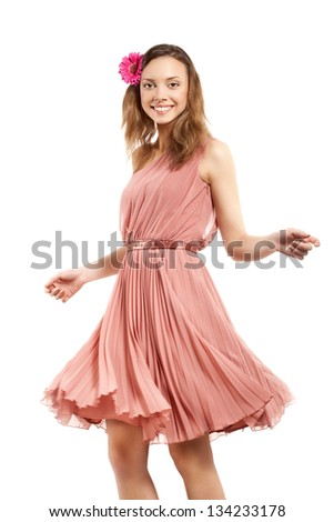 Young lady in pink dress dancing, not isolated on white background - stock photo