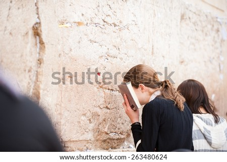 young lady jew at the wailing western wall, jerusalem, israel - stock photo