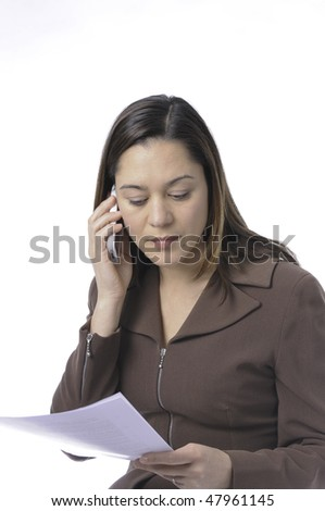 Young lady of filipino ethnicity,is sitting on stool with a white background.She is read a document.Also listening on the telephone. - stock photo
