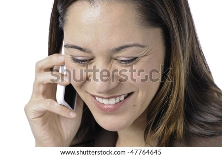 Young lady of filipino ethnicity,is sitting on stool with a white background.She listening on the telephone.With a smile on her face. - stock photo