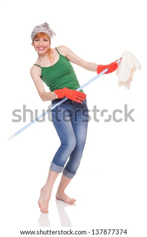 young lady playing the broom like a guitar. isolated on white background - stock photo