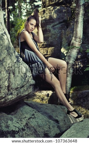 Young lady posing in the mountains - stock photo