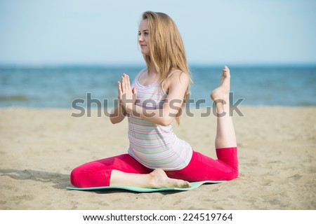 Young lady practicing yoga. Beautiful woman posing at the summer sand beach. Workout near ocean sea coast. Fit tan girl. Fitness model caucasian ethnicity outdoors. Weight loss exercise. Meditation. - stock photo
