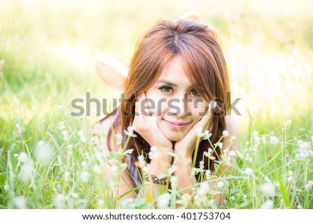 Young lady relax in natural garden